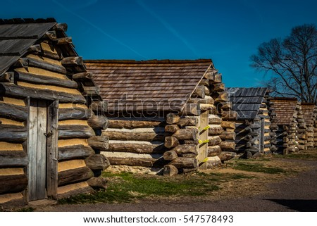 Row of reproduction rustic cabins used by Revolutionary War soldiers under command of General Washington during the winter of 1777-78. Located in Valley Forge National Historic Park, Pennsylvania, USA