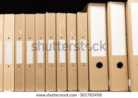 row of ring binders made from recycle paper