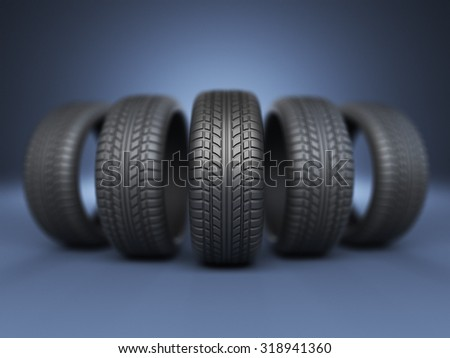 Row of rubber tire 3D, on blue background - stock photo