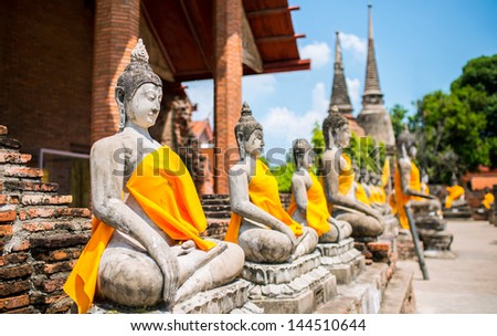 Row of Ruin images of Buddha in Ayutthaya historical park - stock photo