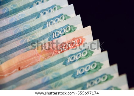 row of russian banknotes on black background. paper money for illustration