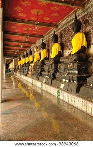 Row of Sacred Buddha images - stock photo
