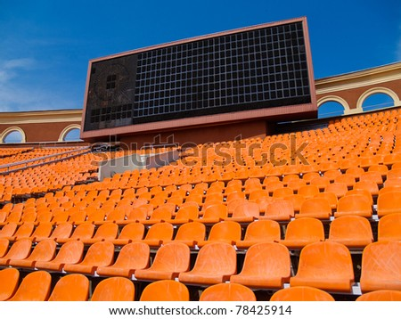 row of seats and score board - stock photo