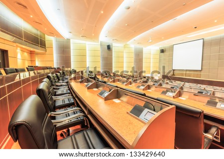 row of seats in empty conference room - stock photo
