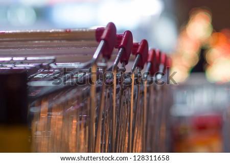 Row of shopping carts at supermarket entrance - stock photo