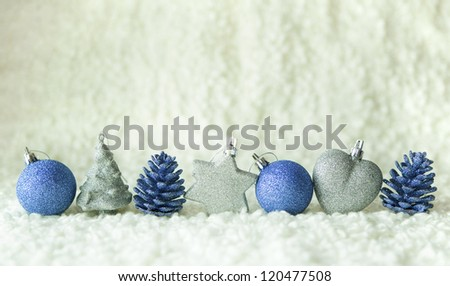 Row of silver and blue decoration elements on the white background - stock photo