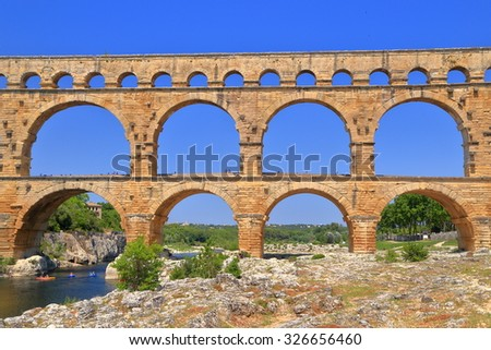 Row of stone arches across a riverbed, Pont du Gard near Nimes, France