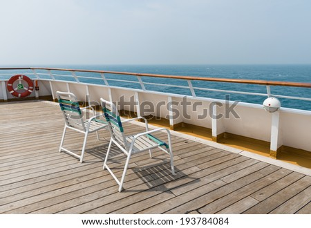 row of sun chairs  on the ship deck