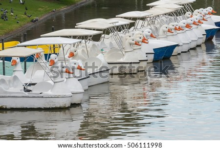 Row of swan boats style in the lake.