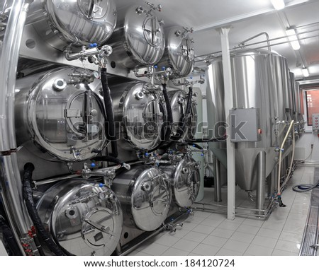 Row of tanks in microbrewery - stock photo