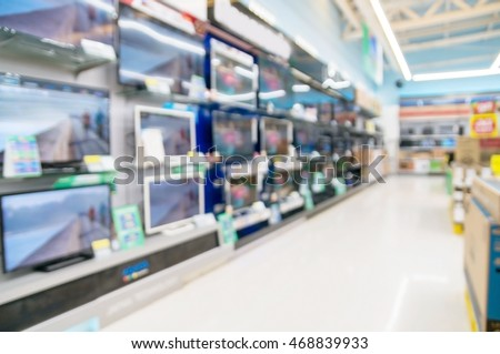 Row of Television on Shelf in Hypermarket, Supermarket or Electronic Home Appliance Shop. Abstract Blur or Defocus Background.