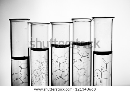 Row of test tubes in black and white style. - stock photo