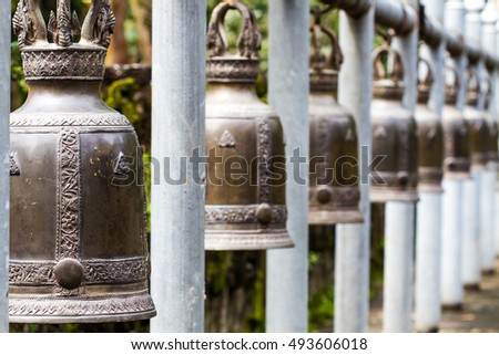 Row of Thai style bells in buddhist temple