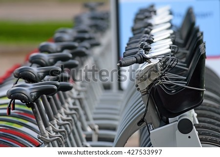 row of the city bicycles for rent at the pick up point landscape view
