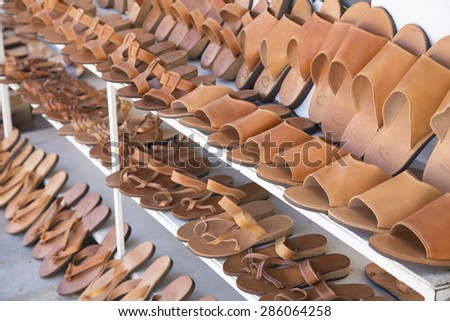 Row of the hand made leather slippers - stock photo
