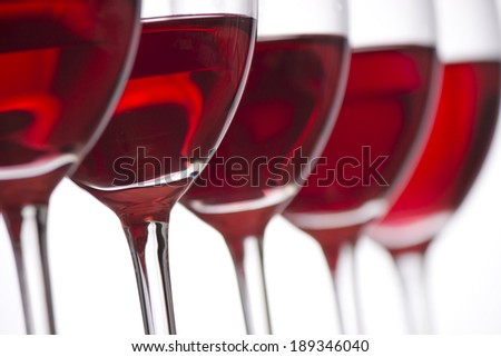 Row of the wine glasses on white background. Selective focus - stock photo