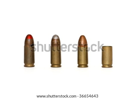Row of three 9mm Parabellum cartridges of several types and spent case isolated - stock photo