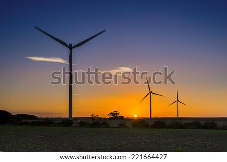Row of three wind turbines at sunset near Lynemouth, England