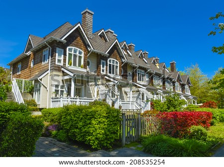 Row of townhouses in Vancouver, British Columbia. - stock photo