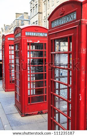 Row of traditional red phone booth in england