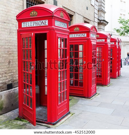 row of traditional red phone boxes in London, UK