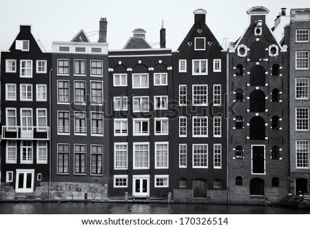 Row of very important mansions, located at the side of a canal, in Amsterdam, capital of the Netherlands, with the time having crooked the once straight lines of the architecture