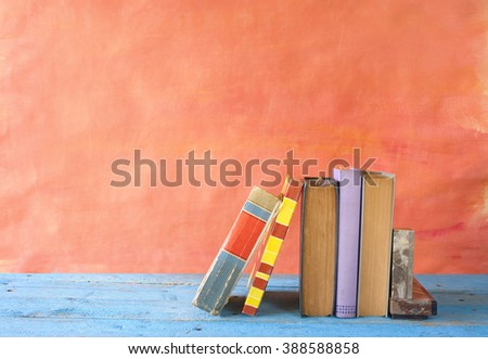row of vintage books, free copy space - stock photo