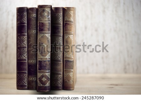 Row of vintage books with one book pulled out - stock photo