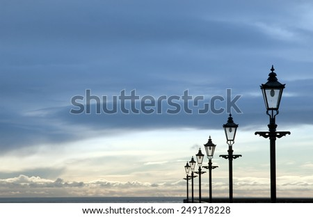 row of vintage lamps on the promenade in Youghal county Cork Ireland - stock photo