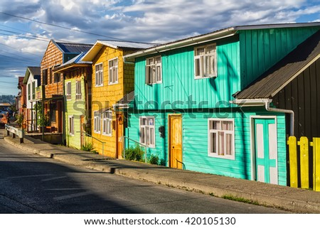 Row of vivid colourful timber, wooden houses, Castro, Chiloe Island, Chile. Lighted by warm summer light. - stock photo