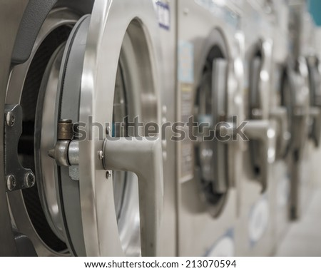 Row of washing machines at a public laundrette - stock photo