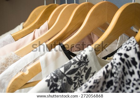 row of white dress in wardrobe at home - stock photo