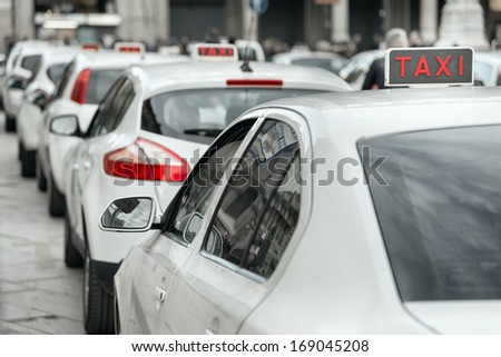 row of white taxi - stock photo