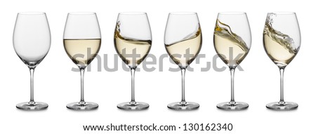 row of white wine glasses, full, empty and with splashes. - stock photo