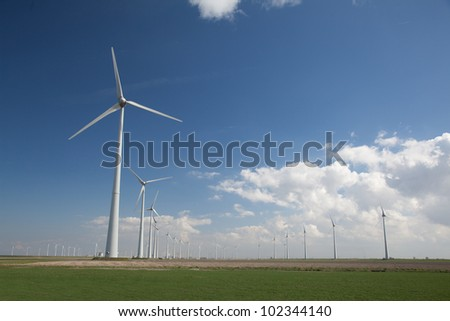 Row of wind turbine producing alternative energy - stock photo