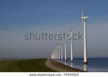 Row of windmills - stock photo