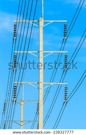 row of wire pole electricity post