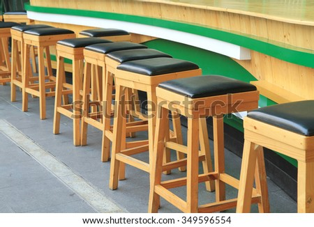 Row of wooden bar stools