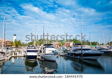 Row of yachts at the harbor in Phuket boat lagoon - stock photo