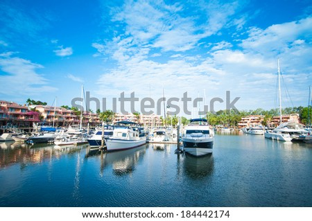 Row of yachts at the harbour in Phuket boat lagoon - stock photo