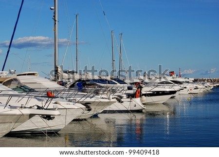 Row of yachts moored in the harbour, Puerto Banus, Marbella, Costa del Sol, Malaga Province, Andalusia, Spain, Western Europe. - stock photo