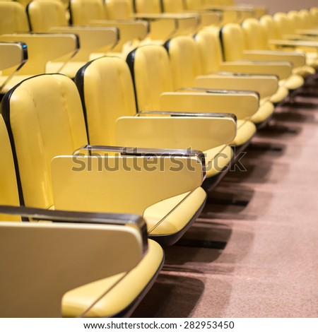 Row of yellow seat in auditorium prepare for study or conference or show - stock photo