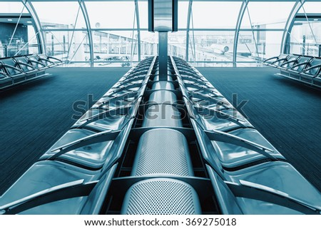 Row seats for passengers in the airport lobby. in the background of the events at the airport. Technical blue colored. Selective focus. - stock photo