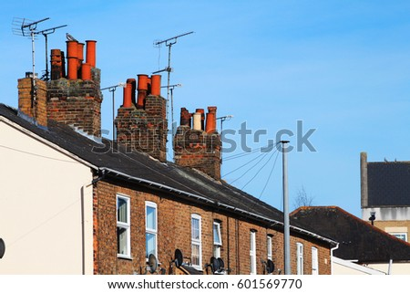 row terraced house with lovely blue sky in spring, England UK. Brick building by the road and environment.