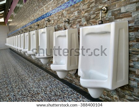 row white urinals in men's toilet - stock photo