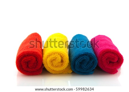 Row with colorful rolled towels isolated over white