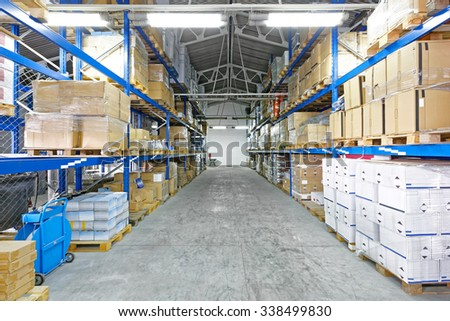 Row with Goods at Pallets in Distribution Warehouse - stock photo