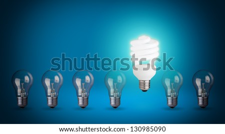 Row with light bulbs and energy save bulb. Idea concept on blue background - stock photo