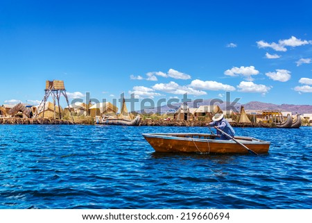 Rowboat at Uros floating islands on Lake Titicaca near Puno, Peru - stock photo