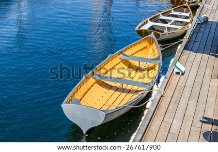 Rowboat Tied up to a Wooden Jetty - stock photo
